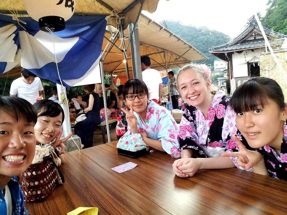 Picture of smiling exchange students around a table