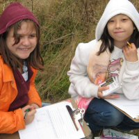 Image of two girls participating in a natural resources program