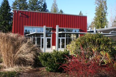 Willis Tucker Park Administrative Office is a red building with a flat roof and large glass windows and doors.