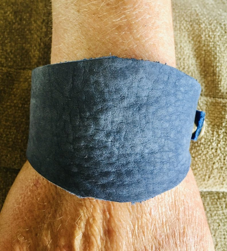 Blue leather bracelet on a white person's wrist