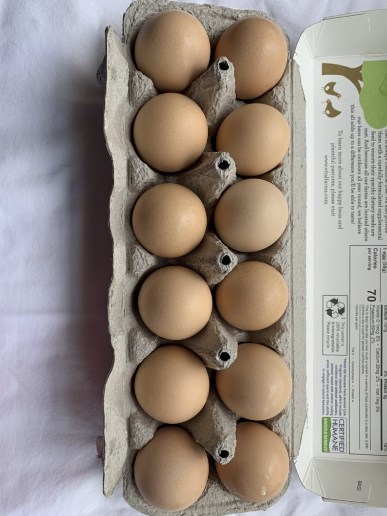 one dozen eggs in a carton
