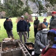 farmer teaching Ag Summit students about vermiculture