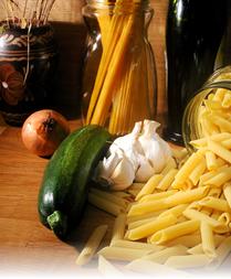 onion, garlic, zucchini, and pasta
