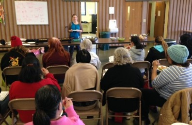 Adult Educator Erin works with class participants at the Des Moines Area Food Bank.