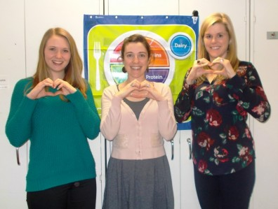 Food $ense staff members Kelsey, Anna, and Jen show their support for heart health.