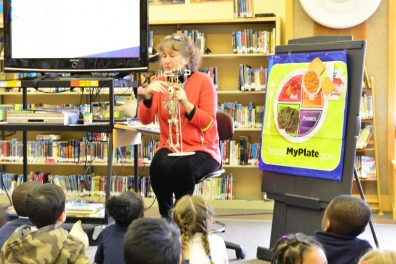 Nancy Hallberg, White Center Heights librarian, shares with students the importance of the dairy group for bone health.