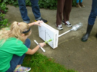 A 4-H club member measures her launch angle before testing her rocket.