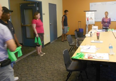 Participants in an Eating Smart, Being Active class prepare to flex their muscles.
