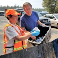 Waste Wise volunteer helping someone learn recycling rules