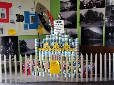 picture of 4000 cans of tuna stacked into a tower