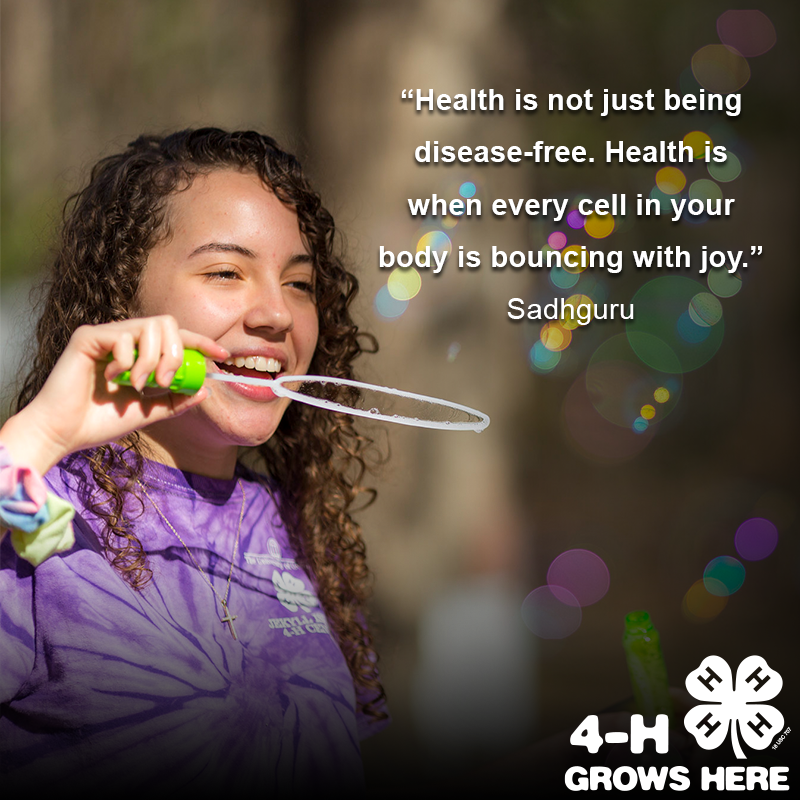 girl blowing bubbles with quote about health and happiness