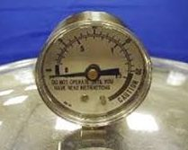 Dial pressure gauge - these kind need to be tested for accuracy every year.
