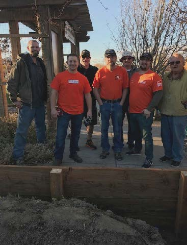 Volunteers and donations from Home Depot helped build six new raised beds