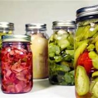 quart jars of pickled vegetables and fruits