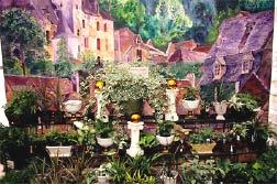 This high end garden center features hand painted murals on the interior walls to help set off the nearby plants.