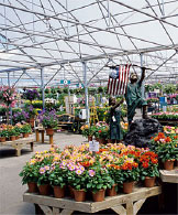 This Oregon garden center offers wide isles, a beautiful glass covering, excellent ventilation, and well displayed plant material.
