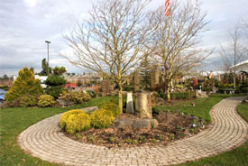 Having a nicely landscaped display garden at the front entrance of a garden center sets the stage for shopping.