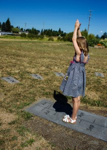 Child standing at the sundial feature at Heritage Farm.