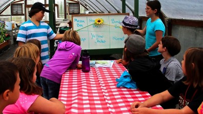 Youth giving a pollinator presentation.