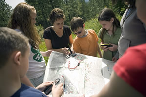 4-H youth using maps and compasses to learn navigation skills.