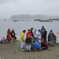 4-H members digging in the sand