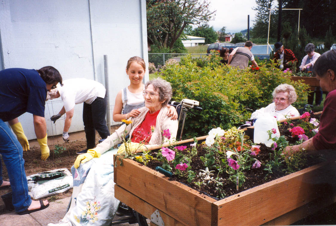Youth working with Elderly in the Garden.