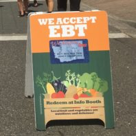 "Orange and green sidewalk sign with ""WE ACCEPT EBT"""