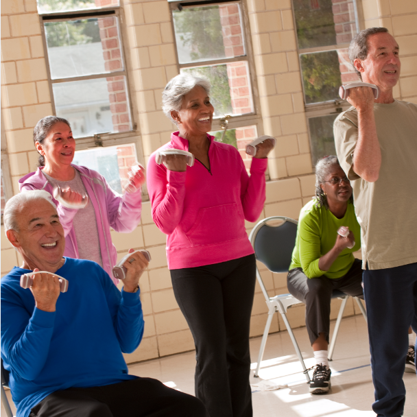 Older Americans exercising with hand held weights