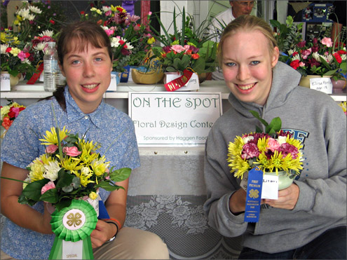 Two young ladies showing award winning plants
