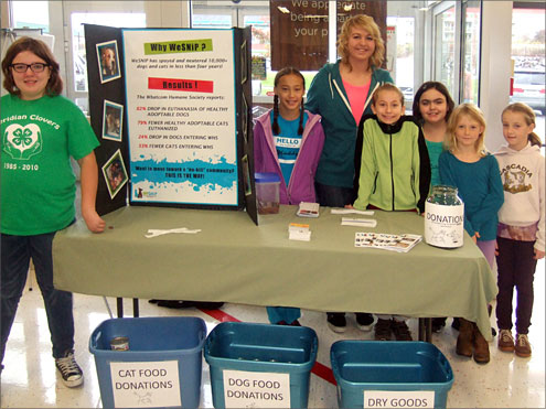 4-H Children posing near Pet Food donation site