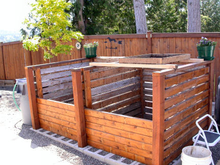 large two section compost bin made of wood
