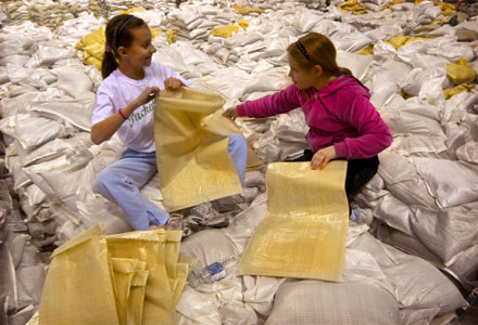 Children preparing sand bags