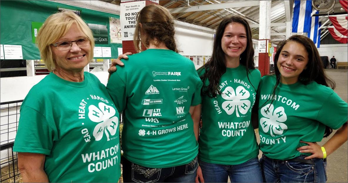Four women wearing matching 4-H shirts