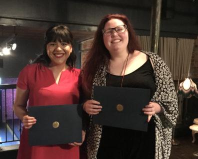 2 scholarship recipients smile broadly.