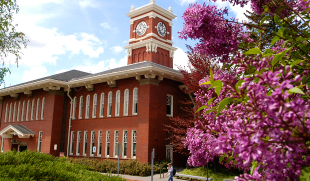 Bryan Tower and Kimbrough Hall on with blooming lilac bush in foreground on the WSU Pullman campus.