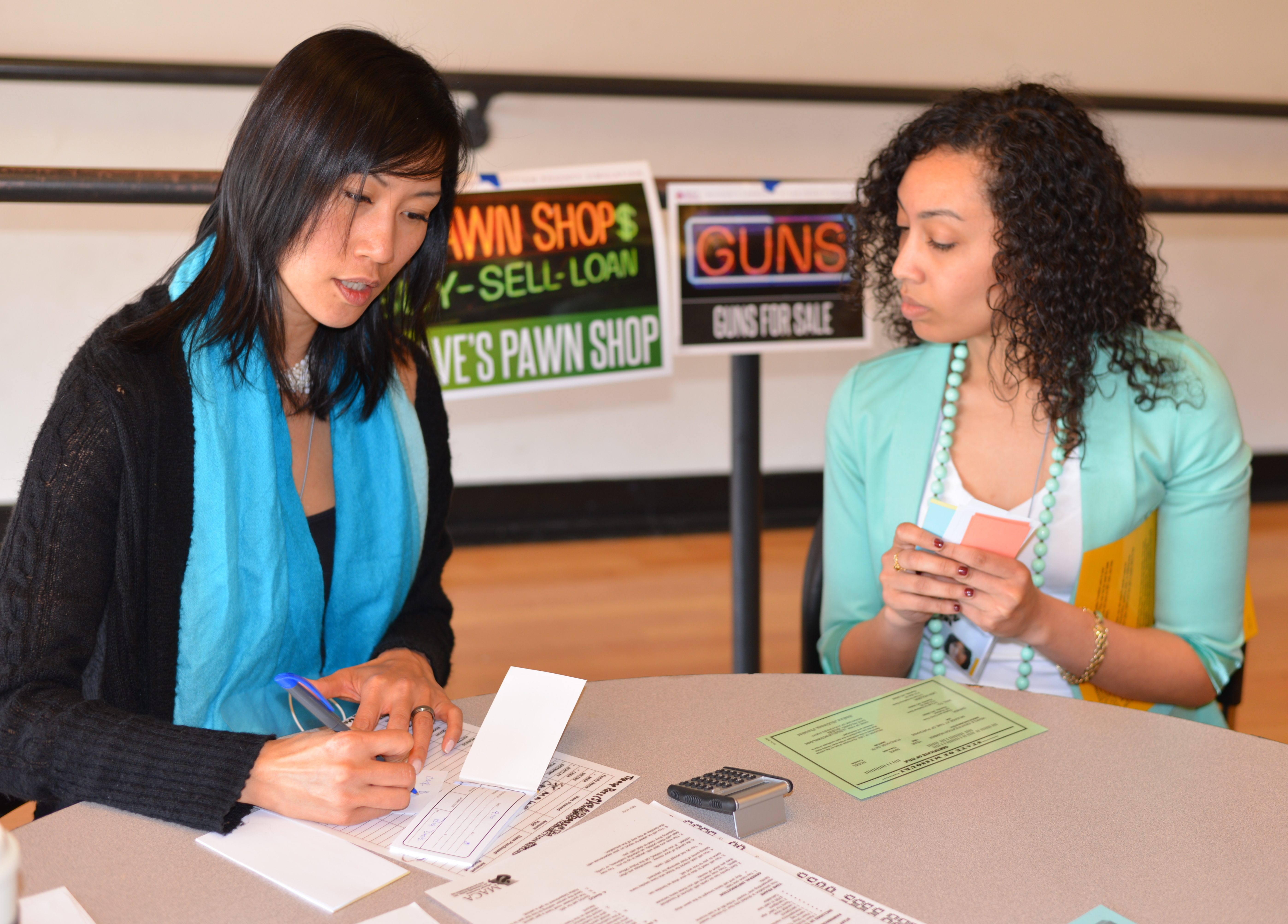 Two women participating in a Poverty Immersion Workshop