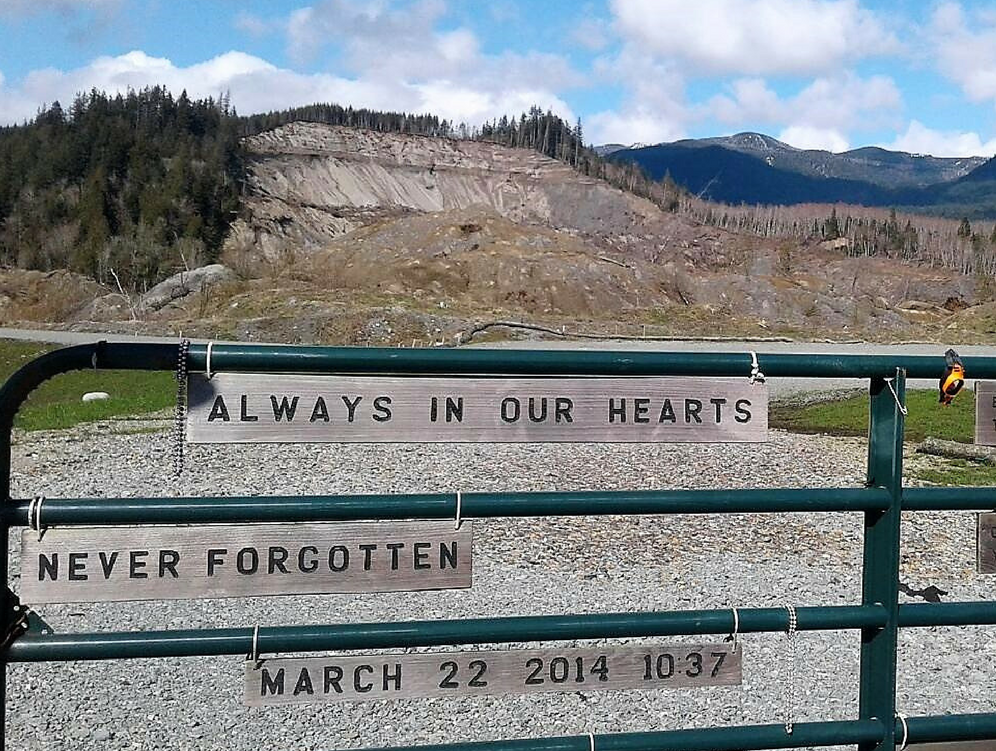 landslide site memorial with sign: Always in our hearts, never forget - March 22, 2017 10:37