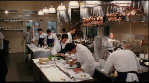 a lot of cooks working in kitchen