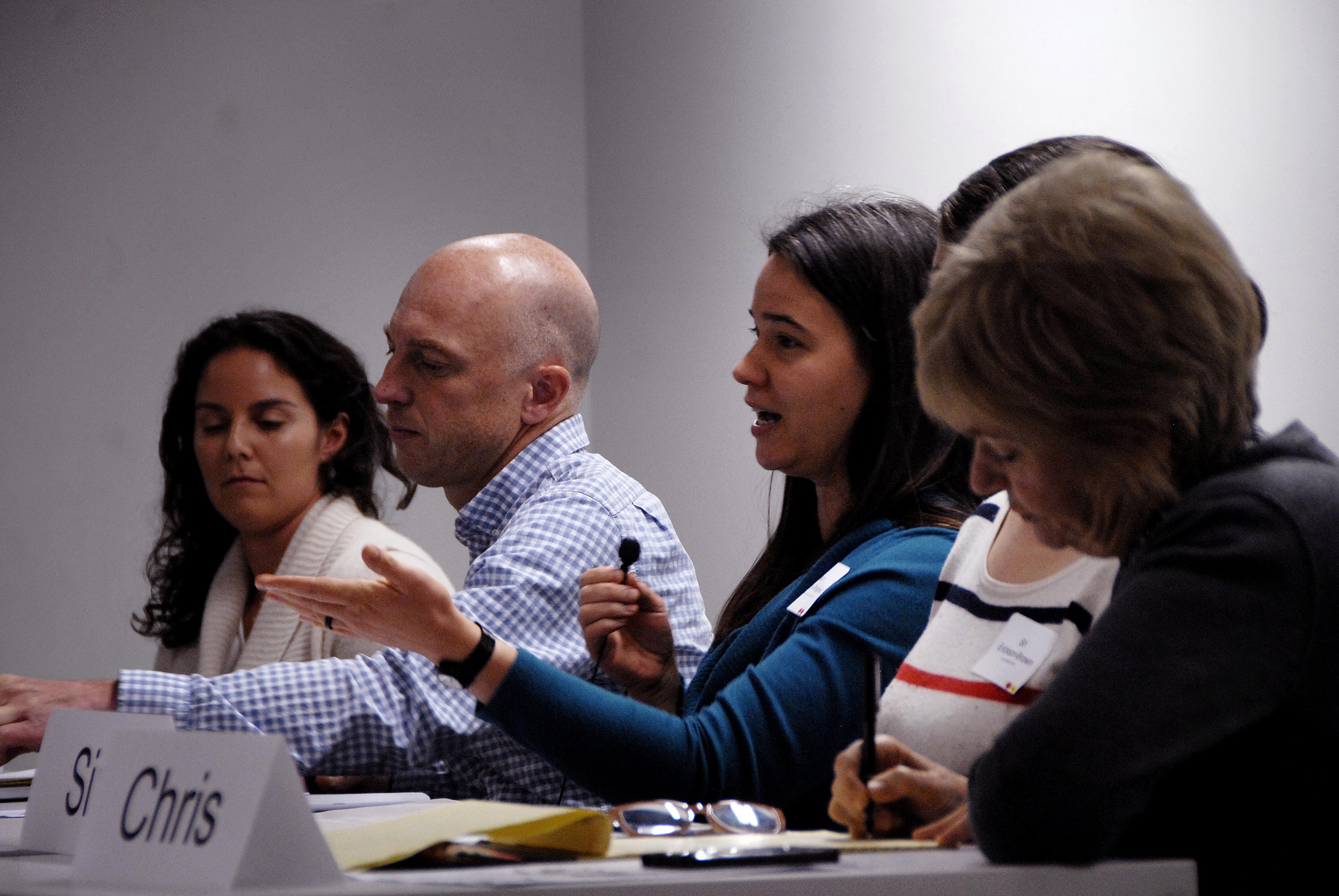 Panelists speaking at summit