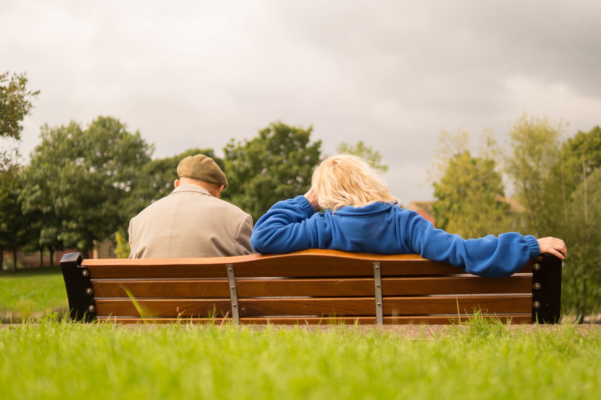 Elderly couple sitting on bench at the park