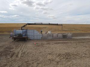 A wind tunnel in a field.