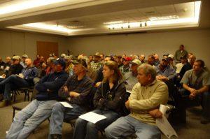 Crowd at a deep furrow drill prototype development meeting