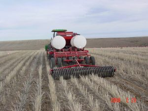 Rear view of LDRS Kile Drill seeding in a field