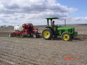 Tractor and LDRS Kile Drill in a field
