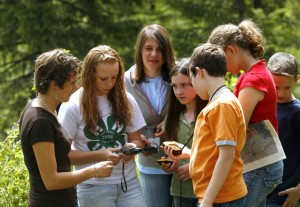A group of students performing an experiment with their teacher.