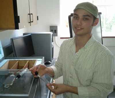 A young man in a lab.