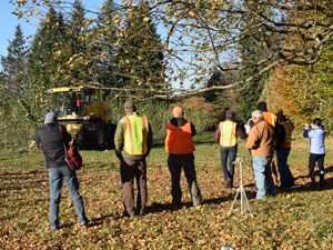 A group watching the harvester at work.