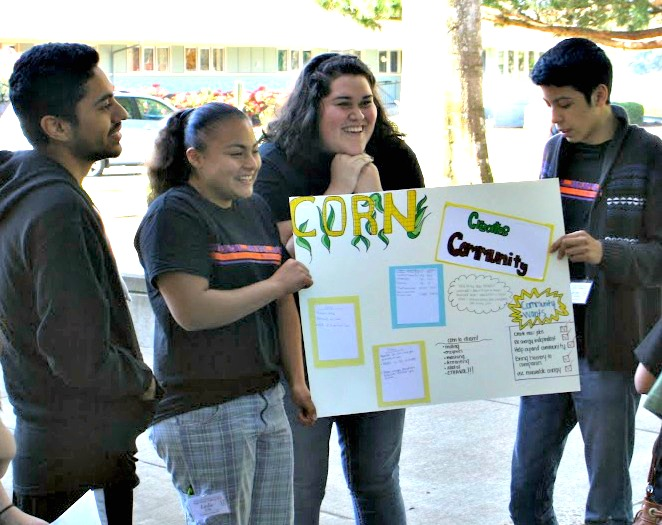 Students holding a poster about corn.