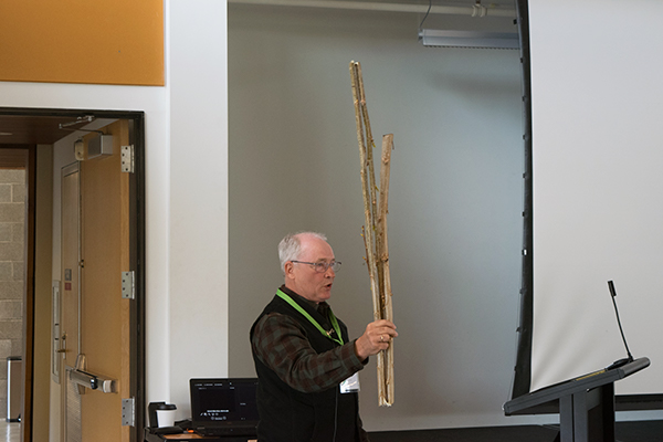 Lou Licht, President and Founder of Ecolotree Inc. giving a spirted presentation on using poplar trees to clean up landfill sites.