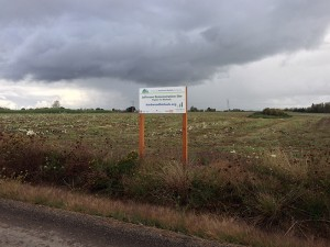 The Jefferson Demonstration Site sign and behind it the newly harvested field.